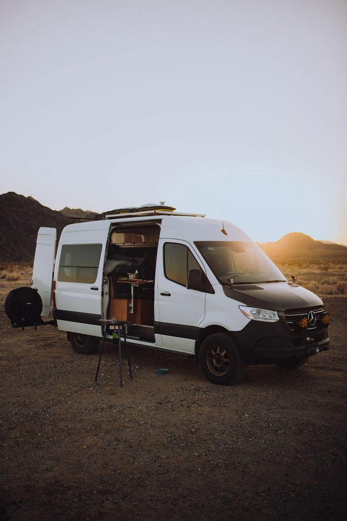 Cameron's van parked in the desert ready for camping.