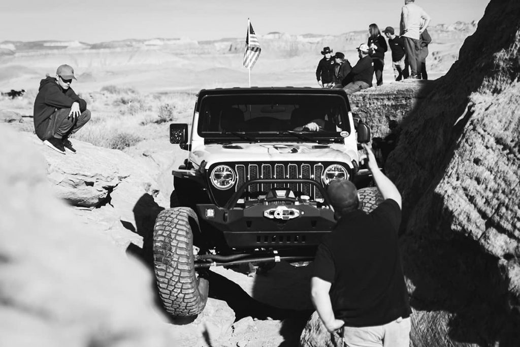 A Jeep eases through an obstacle on a rock crawl course in Sand Hollow State Park (Hurricane, Utah).