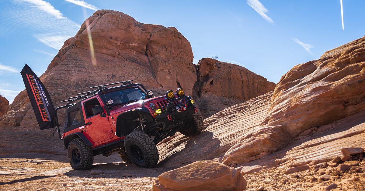 David's Jeep sits on a rock slope prior to acending The Chute.