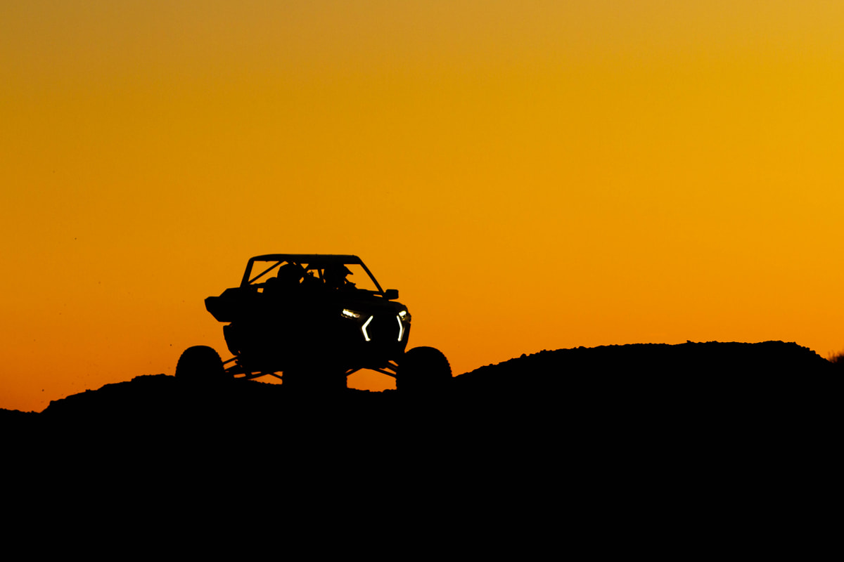 A silhouette of a UTV during sunset.