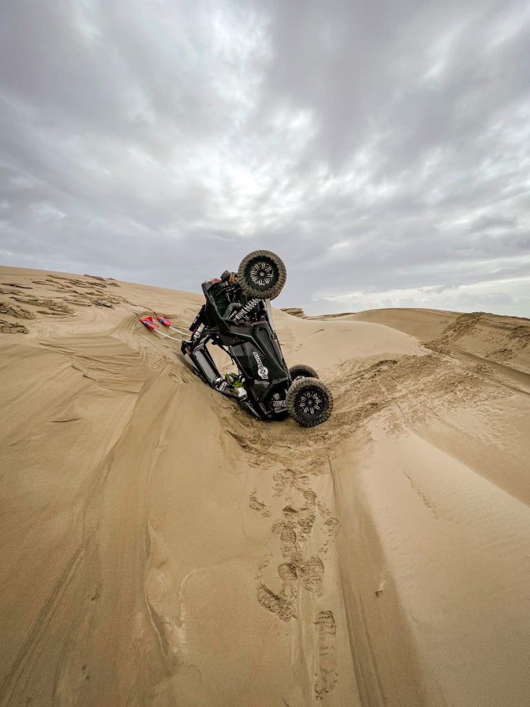 A side view of the SxS Guys UTV flipped upside down.